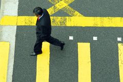 Businessman in a hurry. Business man in a hurry in a pedestrian cross walk Royalty Free Stock Photography