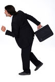 Businessman in a hurry Royalty Free Stock Images