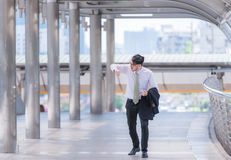 Businessman in a hurry checking time and running, he is late for work his business appointment. Royalty Free Stock Image