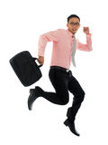 Businessman in hurry. Full body young attractive Asian businessman in hurry running or jumping up with a briefcase, isolated on white background Royalty Free Stock Photos