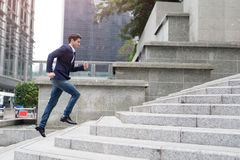Businessman in hurry. Motion blurred people over office building in hongkong Stock Image