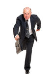 Businessman hurrying to job. Isolated on white background Royalty Free Stock Image