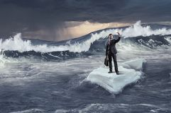 Surfing sea on ice floe. Mixed media. Businessman on ice block floating in sea and making selfie. Mixed media Stock Image