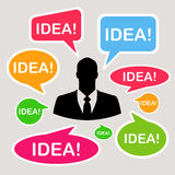 Businessman icon with colorful speech or comment bubbles Royalty Free Stock Photography