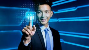 Businessman with icon. Businessman touch business icon on blue background Royalty Free Stock Images