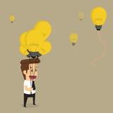 Businessman with idea bulb balloon Royalty Free Stock Photos