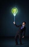 Businessman with an idea bulb Royalty Free Stock Image