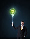 Businessman with an idea bulb Stock Images