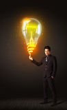 Businessman with an idea bulb Royalty Free Stock Images