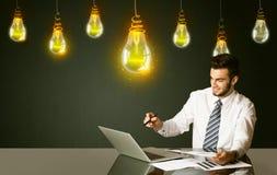 Businessman with idea bulbs Royalty Free Stock Photos