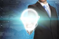 Businessman Idea lightbulb concept. Business man holding a lightbulb in his hand Stock Photo