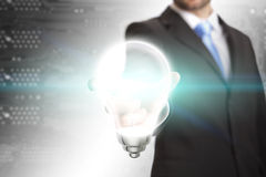 Businessman Idea lightbulb concept. Business man holding a lightbulb in his hand Royalty Free Stock Images