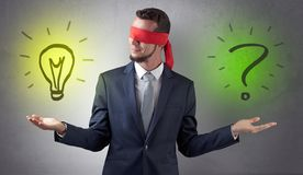 Businessman with idea versus question concept Royalty Free Stock Photos