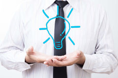 Businessman with illuminated light bulb concept for idea, innova stock photos