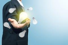 Businessman with illuminated light bulb Royalty Free Stock Photo