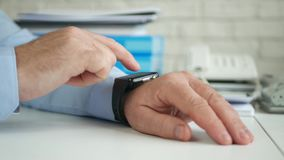 Businessman Image in Office Room Accessing Smartwatch Online Email Application.  stock video