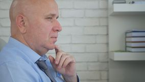 Businessman Image Thinking Pensive in Office Room. Image with a Businessman Thinking Pensive in Office Room stock photos