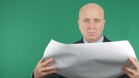 Businessman Image Working With Plans and Green Screen in Background.  royalty free stock photography