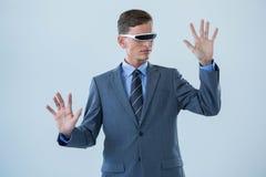 Businessman imagining while using virtual reality glasses Royalty Free Stock Photo