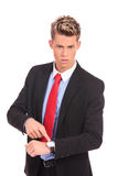 Businessman impatiently pointing to his watc Stock Images