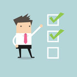Businessman with important checklist Royalty Free Stock Images