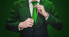 Businessman In Green Suit Tying Green Necktie. Environment, Agriculture And Green Business Royalty Free Stock Photography