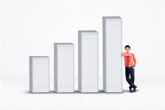 Businessman and increasing bar chart - isolated Stock Image