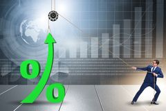 The businessman increasing interest rate in market. Businessman increasing interest rate in market stock images