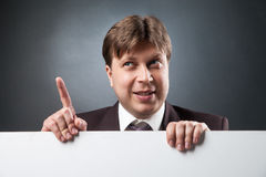 Businessman with index finger up Stock Images