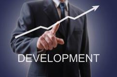 Businessman indicating the development Royalty Free Stock Photo