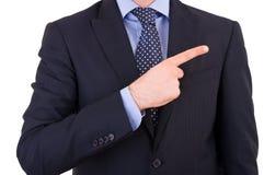 Businessman indicating something. Stock Image
