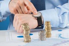 Businessman indicating time Royalty Free Stock Image