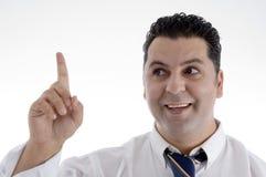 Businessman indicating upward Stock Photo