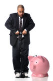 Businessman Inflating Piggy Bank. African American businessman inflating piggy bank over white background Stock Photo