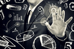 Businessman with infographics Stock Images