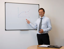 Businessman infront of Board Stock Image