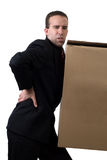 Businessman With Injured Back. A young businessman hurt his back after trying to lift something to heavy, isolated against a white background Stock Photo