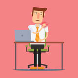 Businessman injured at work suffering from shoulder pain. Royalty Free Stock Images