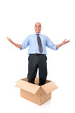 Businessman inside a box Stock Image