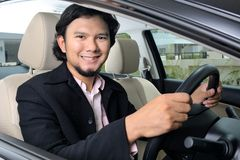 Businessman inside the car Royalty Free Stock Image