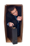 Businessman inside of a cardbox Stock Image