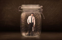Businessman inside a jar with powerful hand drawn lines concept Stock Photography