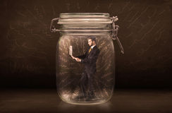 Businessman inside a jar with powerful hand drawn lines concept Royalty Free Stock Photos