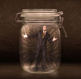 Businessman inside a jar with powerful hand drawn lines concept Royalty Free Stock Photography