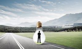 Businessman inside light bulb Royalty Free Stock Images