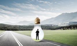 Businessman inside light bulb Royalty Free Stock Photography