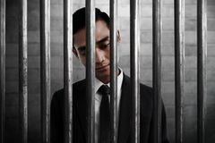 Businessman inside prison with sad expression stock images