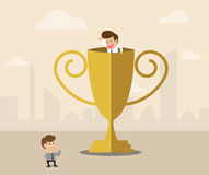 Businessman inside winner trophy has a greeting wi Royalty Free Stock Images