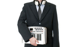 Businessman with instrument with in suit Royalty Free Stock Image