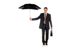 Businessman insurance agent. Handsome businessman,  insurance agent with umbrella.  Studio, white background Royalty Free Stock Photos